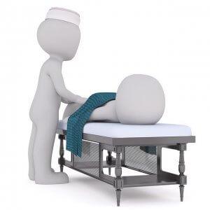 診察台で横になる人型とナースキャップを被る人型
